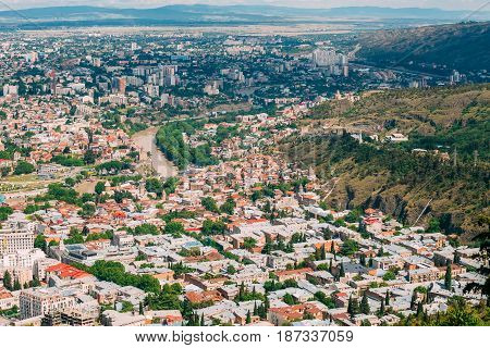 Tbilisi Georgia. Aerial View Of Hillside With Famous Landmarks: Tabor Monastery Of The Transformation, Narikala Fortress And Surb Gevorg Church Among Residential Area With Red And White Roofs.