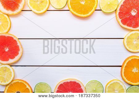 Citrus Background With Copy Space. Citrus Fruits On The Wooden Table With Copy Space