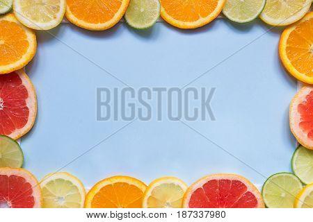 Citrus Background With Copy Space. Citrus Fruits On The Blue Background With Copy Space. Top View