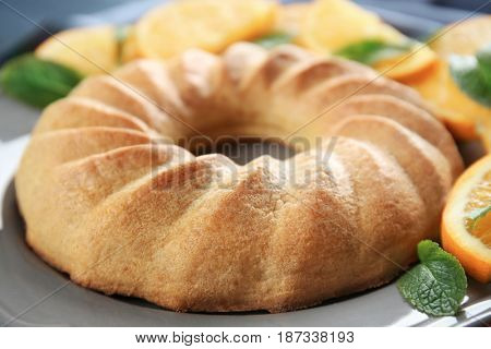 Plate with appetizing citrus cake, close up