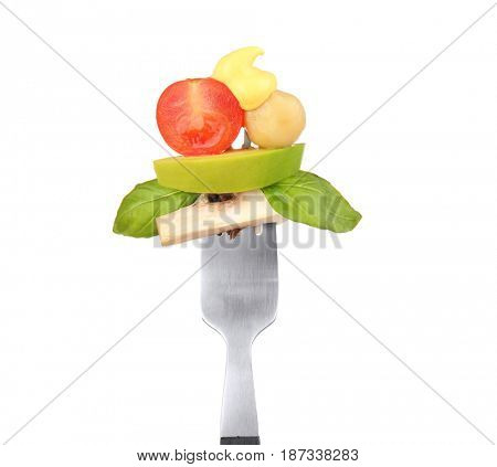 Fork with pinned snack and cheese sauce on white background