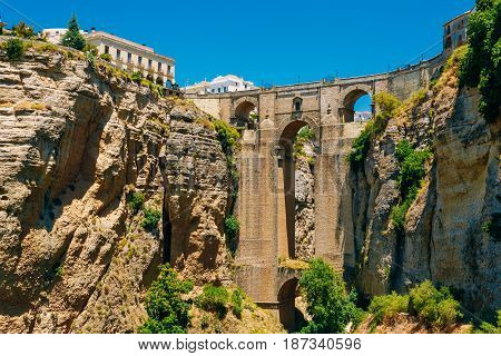 The New Bridge Puente Nuevo is the 120-metre 390 ft -deep chasm that carries the Guadalevin River and divides city of Ronda, Province Of Malaga, Spain