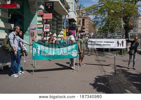 Kiev Ukraine - June 12 2016: Opponents of the parade of a sexual minority with a poster