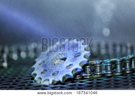Spraying lubricant onto the gear wheel and chain poster