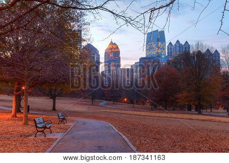 View of the Oak Hill in the Piedmont Park and Midtown Atlanta behind it in autumn twilight USA