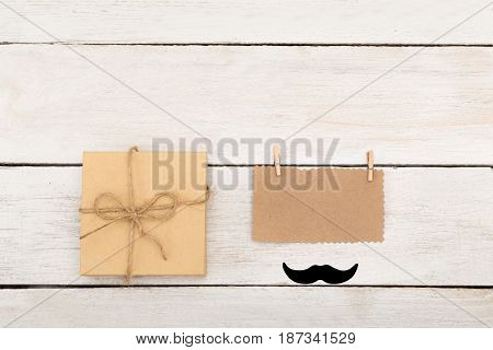 happy fathers day. Mustache, box with gift and place for text