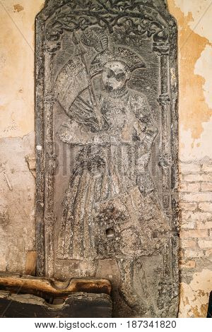 Riga, Latvia. Doorside Stone From The Blackheads House With The Relief Of St Mauritius In Museum Of Dome Cathedral