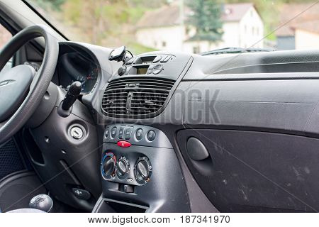 A Cockpit of a car of a fiat car in black