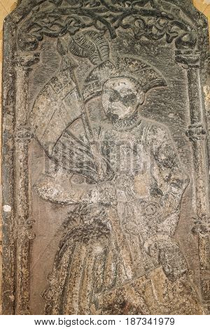 Riga, Latvia. Doorside Stone From The Blackheads House With The Relief Of St Mauritius In Museum Of Dome Cathedral. Details, Close Up.
