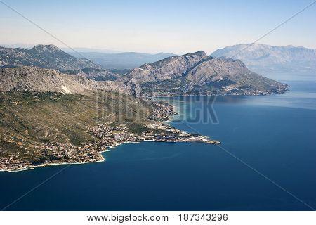 Aerial view - Omis riviera in Croatia town Dugi rat in front plan