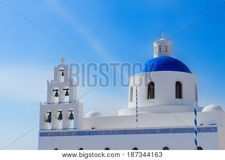 The Orthodox Church Belltower and dome in Oia, Santorini, Greece