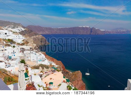 Oia, traditional greek white village, Aegan Sea and caldera of volcano, Santorini, Greece