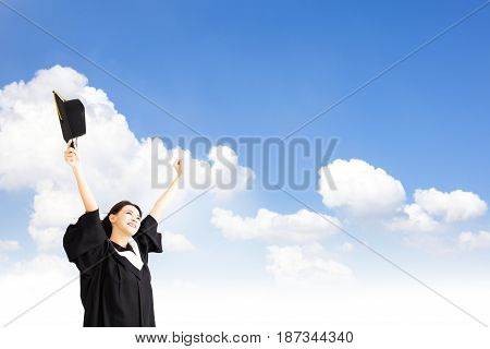 smiling asian Graduate woman with cloud background