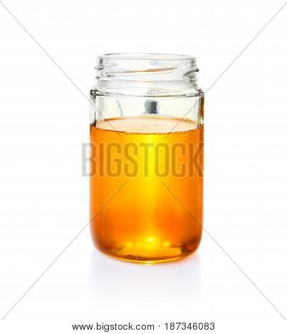 honey in clear glass jar on isolated white background