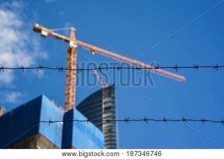 construction of high-rise buildings. barbed wire close up