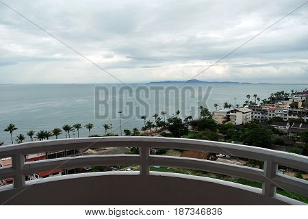 Balcony view to the ocean and neighborhood houses near Jomtien beach area in Pattaya Thailand