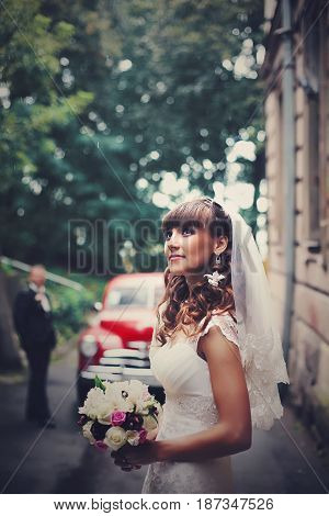 Pretty Bride Stands Outside And Looks Up In The Sky