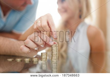 Couple building money columns together in sunset financial growth saving for social security
