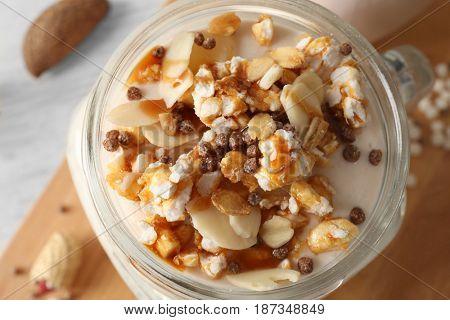 Delicious parfait with granola in jar, closeup