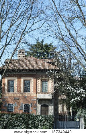 Monza (Brianza Lombardy Italy): exterior of old typical house with garden at March
