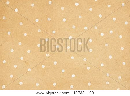 Closeup of brown craft paper with polka dot painting for background