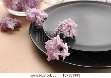 Beautiful festive table setting with lilac flower decor, closeup