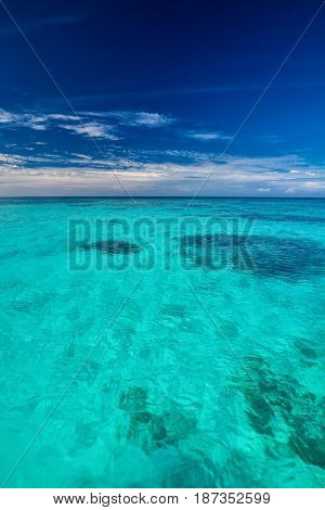 Tropical ocean with blue sky with vibrant ocean colors, Maldives