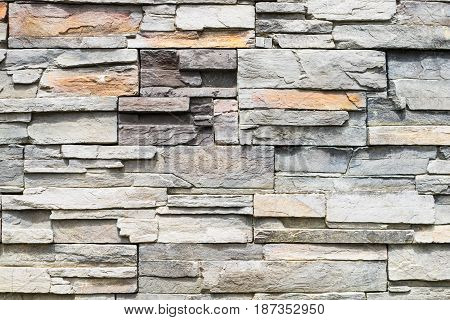 Stone wall facade stone structure background, textured