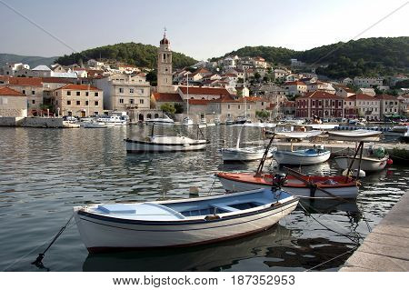 Pucisca harbour with St. Jerome church on island Brac in Croatia
