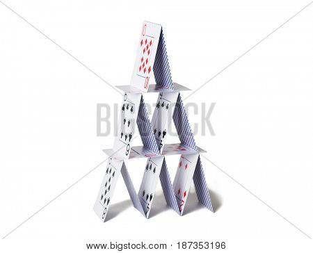 casino, gambling, games of chance, hazard and insecurity concept - house of playing cards over white background