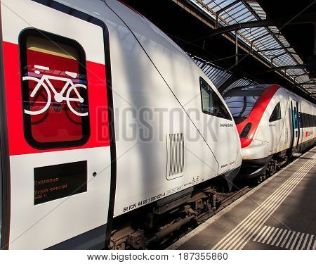 Zurich, Switzerland - 8 May, 2016: two locomotives at a platform of the Zurich main railway station. The Zurich main railway station is the largest railway station in Switzerland and one of the busiest railway stations in the world.