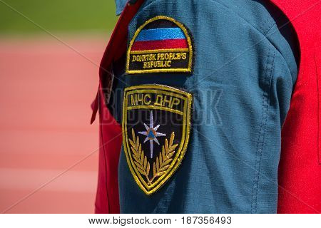 Donetsk Ukraine - April 29 2017: Patch of the Ministry of Emergency Officer on the sleeve
