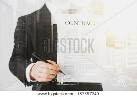 people and business concept - close up of businessman holding contract paper over city with double exposure