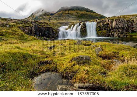 Water going down on Kirkjufellsfoss waterfall in Iceland