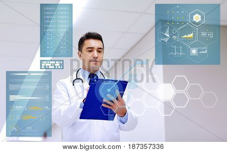 people, healthcare and medicine concept - doctor with clipboard at hospital corridor