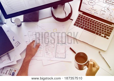 A Man Working Plan Diagram On A White Table