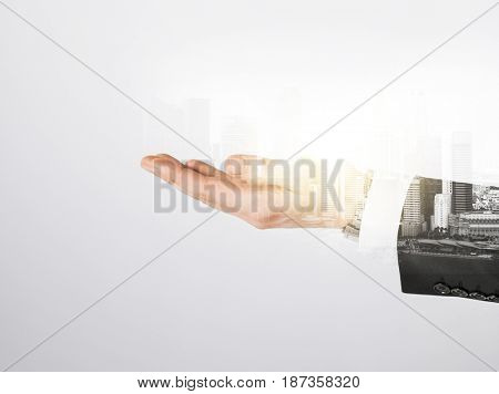business, gesture and people concept - close up of businessman hand over city with double exposure
