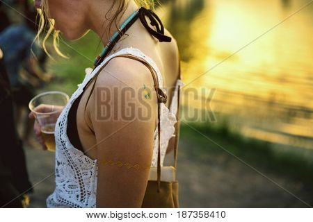 Caucasian woman with summer fashion for music festival