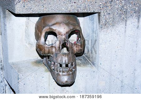 sculpture of the skull on cemetery in small swiss town