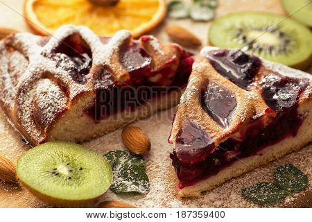 Delicious pie with cranberries decorated with kiwi