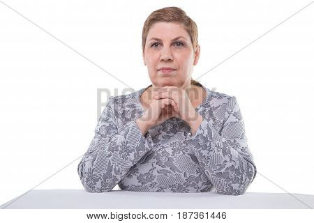 Portrait of thinking old woman on white background