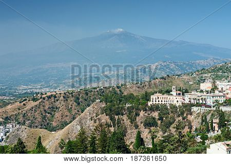 View of a part of Taormina city and the Etna volcano seen from the ancient greek theater Sicily Italy