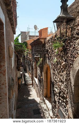 Typical ancient alley in Taormina Sicily Italy