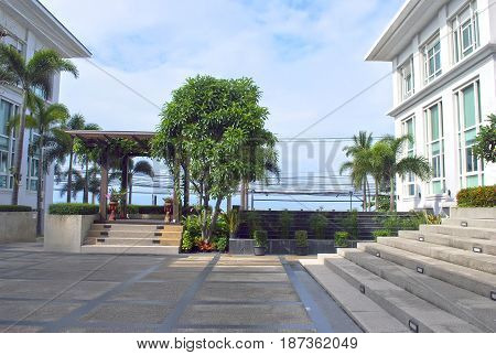 PATTAYA, THAILAND - OCTOBER 09, 2015: Private villa patio with steps awning and landscape design elements. Processed for hdr tone mapping effect. Shot in Pattaya Thailand.