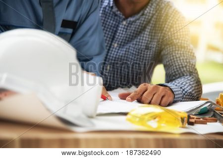 A Person's Hand Pointing On Blue Print