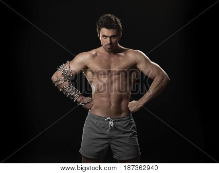 Muscular Man With Chain On Arm