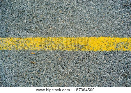 Asphalt with yellow road line abstract bakground