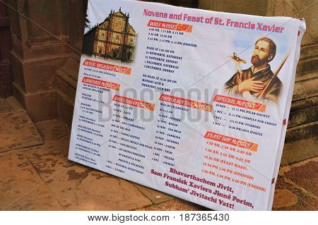 Old Goa, India - November 13, 2012: Tourist sign about religious events in famous landmark - Roman Catholic Church of St. Francis Assisi, Old Goa, India.