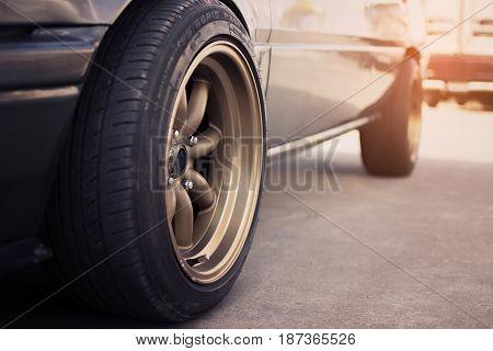 Racing rim wheels in retro car with selective focus.