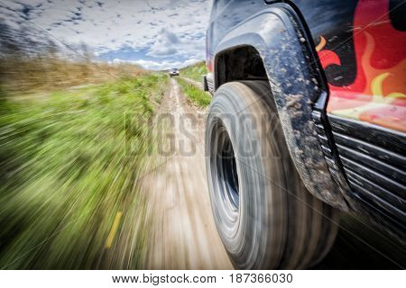 Offroar car moving with high speed in motion blur